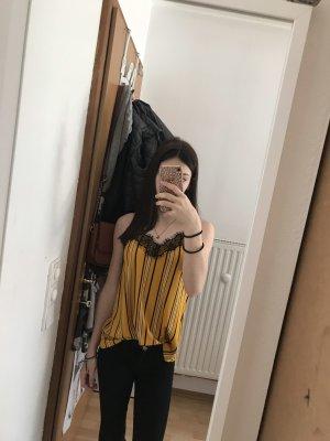 Top de encaje amarillo-negro