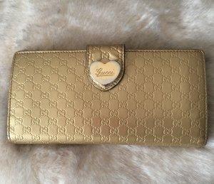 Geldbörse von Gucci in Gold