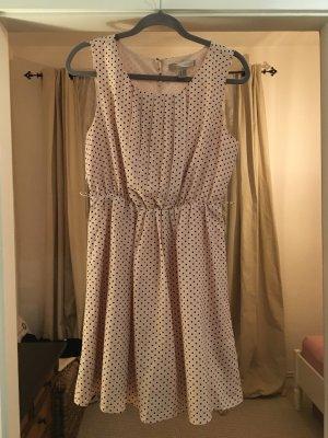 Gepunktetes Kleid in rosa