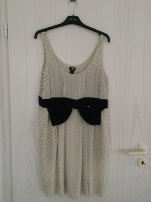 Gepunktetes Kleid mit großer Schleife | H&M | Gr. 46