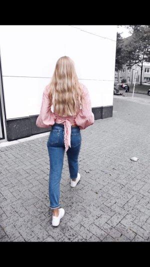 Gestreifte kurzgeschnittene Bluse