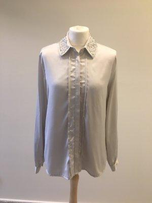 Glänzende  Bluse mit Dekorsteinchen
