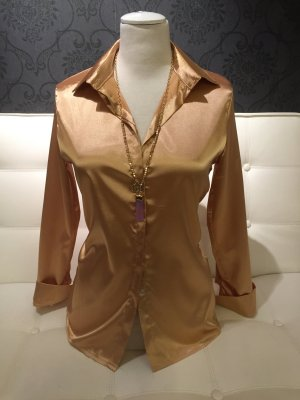 Blusa brillante color oro