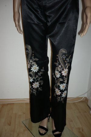 Glänzende schwarze Damenhose mit Glitzerblumen in Gr. 38 / M