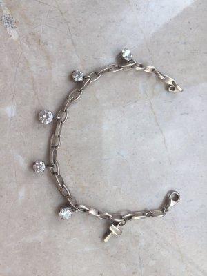 Gliederarmband aus Silber mit durchsichtigen Steinchen und Kreuzanhänger