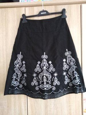 Falda acampanada negro-color plata