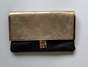 Gold-schwarze Clutch