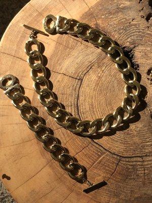 Goldene Gliederkette und -Armband