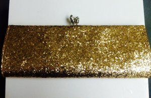 Goldene Glitzerclutch