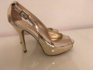 Goldene Guess Stilettos