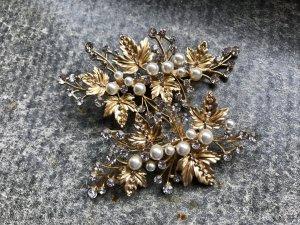 Goldene Haarspangen für die Hochzeit