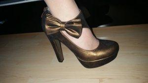 Goldene High Heels mit Schleife
