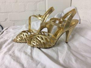 Goldene High Heels von H&M