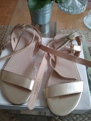 Goldene italienische Sandalen