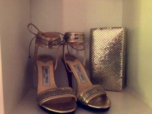 Goldene Jimmy Choo Highheels + Passende Tasche