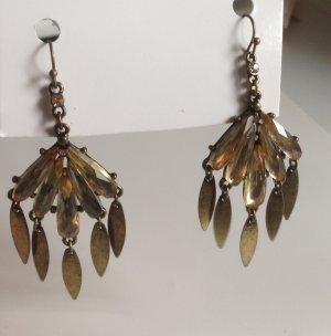 Goldene lange Ohrringe