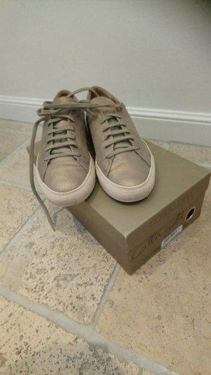 Goldene Leder Sneaker