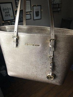 Goldene Michael Kors Tasche