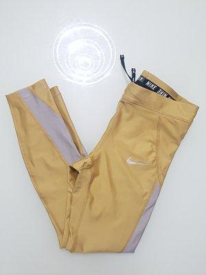 Goldene Nike Fitness Leggings Tights
