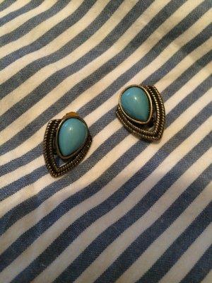 Goldene Ohrringe (Clips) mit Stein