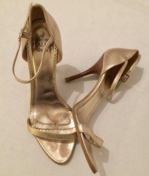 Goldene Riemchen Sandaletten mit Absatz