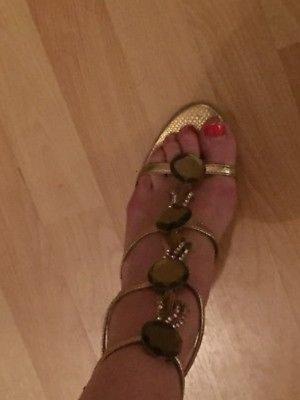 Goldene Römer High Heels Sandalen mit viel Bling Bling