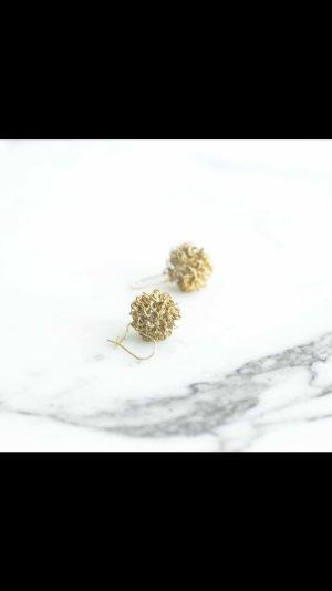 Goldene runde Ohrringe