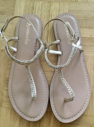 Goldene Sandalen von Accessorize mit Steinchen in 39