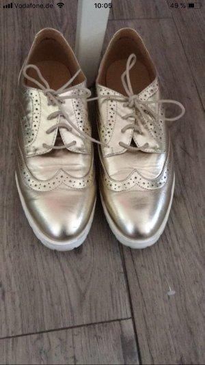 Goldene Schuhe von Graceland