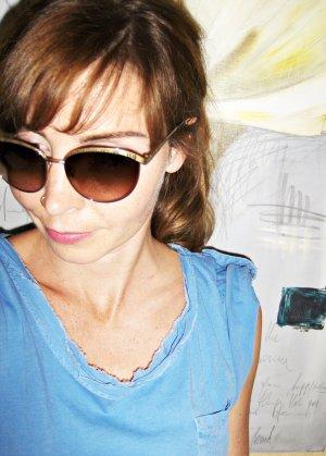 goldene,sehr extravagante Sonnenbrille mit braunen Glaesern,Marke Coach