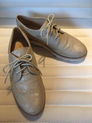 goldene Sneaker