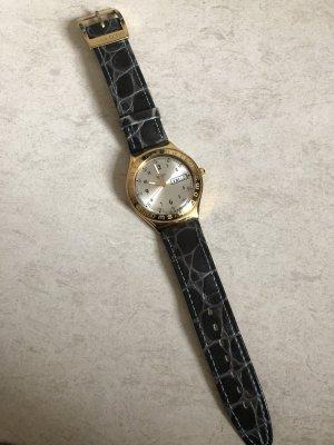 Goldene Swatch Uhr