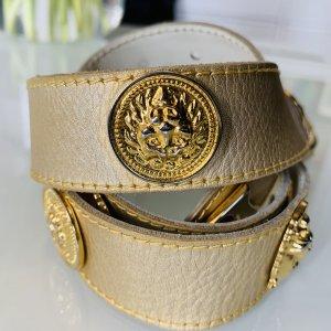Cinturón de cuero color oro