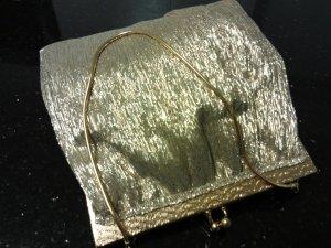Bolso de mano color oro Fibra sintética
