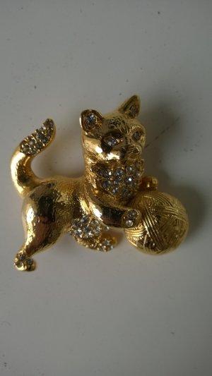 Goldfarbene Brosche mit Strasssteinen(Tiermotiv)