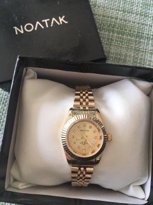 Reloj color oro