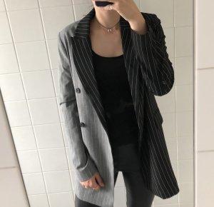 grau-schwarzes Blazer