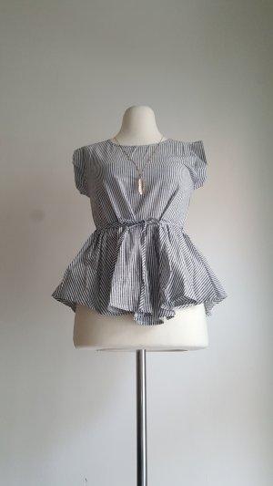Mouwloze blouse grijs-wit Polyester