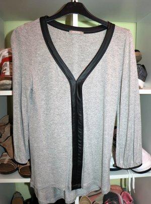 Graue bluse mit Lederdetails