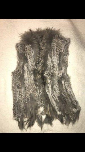 Smanicato di pelliccia grigio chiaro-grigio