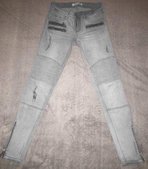 Graue Jeans mit Reisverschlussdetails