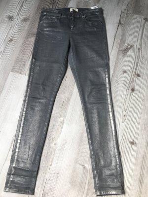 Graue Jeans mit seitlichem Streifen und silbernen Schimmer