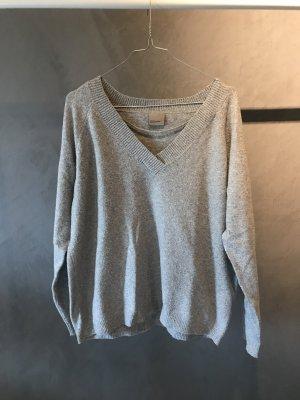 Graue Pullover