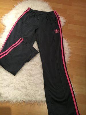 Graue schimmernde Nike Hose