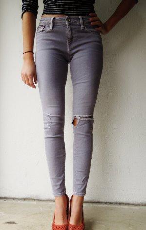 Graue Skinny Jeans mit Rissen von Tommy Hilfiger