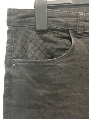 Graue Skinny Jeans mit schwarze Strass an den Taschen