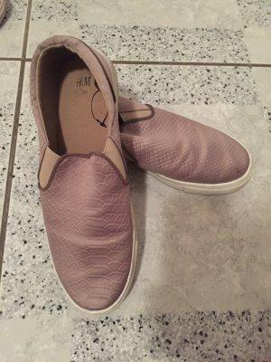 Graue Slipper von H&M