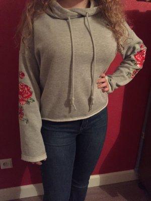Grauer Kapuzenpulli aus Sweatshirt- Stoff