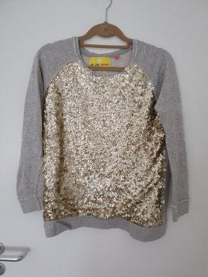 Grauer Pullover mit goldenen Pailletten