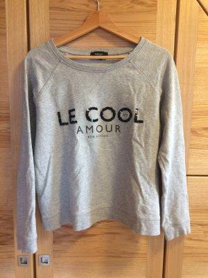 Grauer Pullover mit Paris Motiv